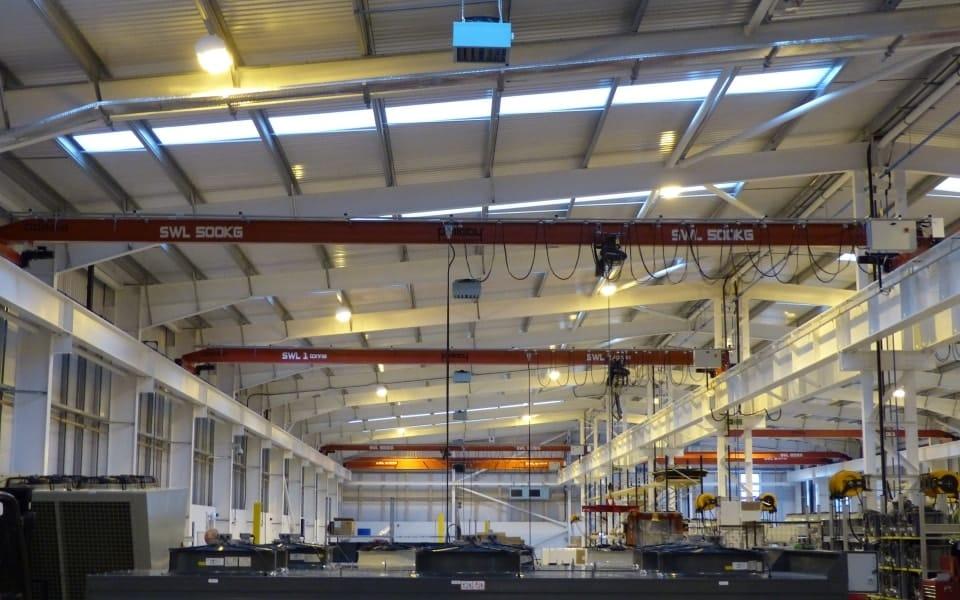 Several Single Girder Overhead Cranes in a Warehouse