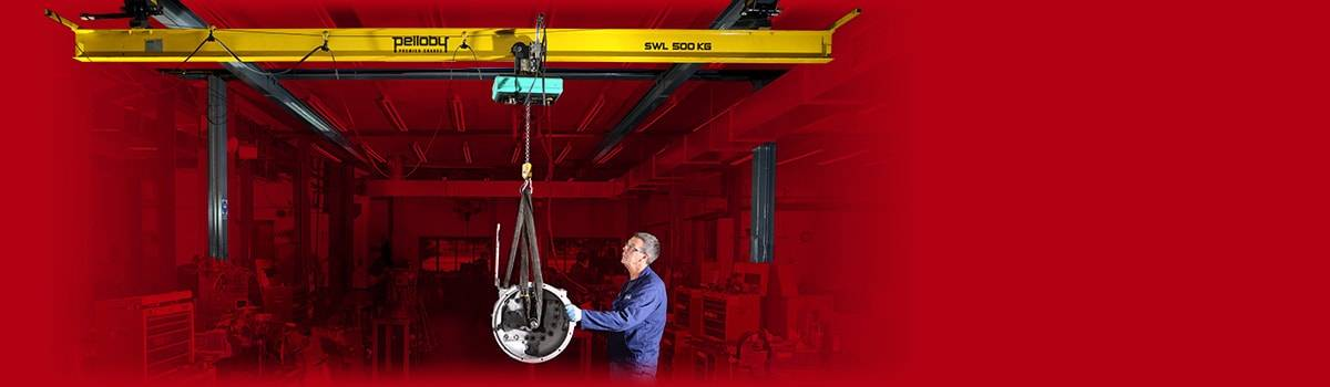 Man operating yellow overhead crane