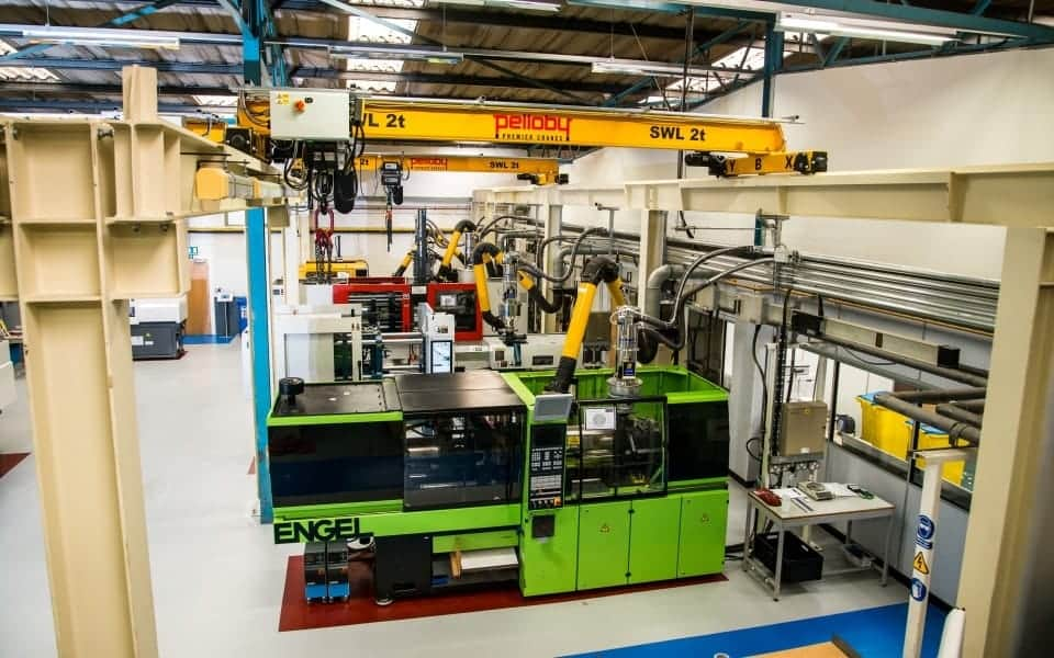Two Pelloby Beam Cranes Above Injection Moulding Machines